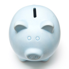 Blue piggy bank isolated on a white studio background.