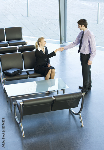 A businessman greeting a client or job candidate