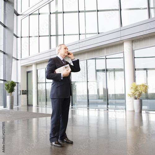A mature businessman talking on mobile phone