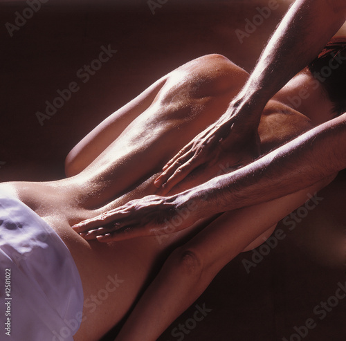 Man's hands massaging a woman's back 04
