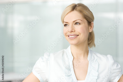 A portrait of a blonde businesswoman smiling