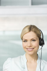 A blonde woman wearing a telesales headset