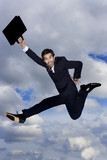 A businessman with briefcase, leaping in the air