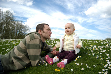 Father with the baby outside on grass