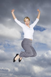 A businesswoman leaping in the air