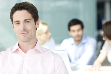 A male business project leader at a team meeting