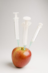 apple with three syringes