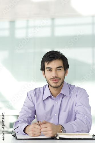 A portrait of a businessman sitting at a desk