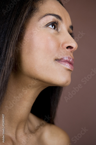 A portrait of a young woman smiling, side view