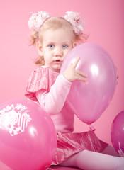 Girl and pink balloons