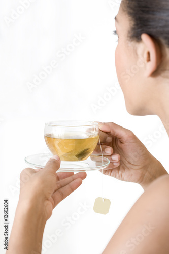 A woman drinking a cup of herbal tea