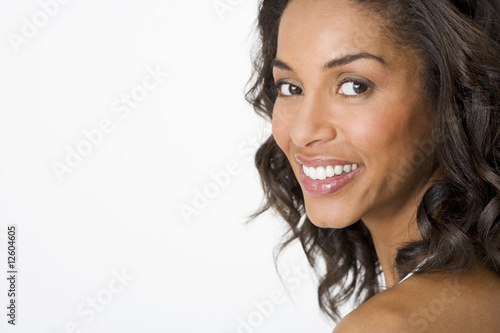 A portrait of an attractive young woman smiling
