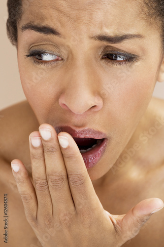Close-up of young woman yawning
