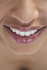 Close-up of a woman's mouth, smiling