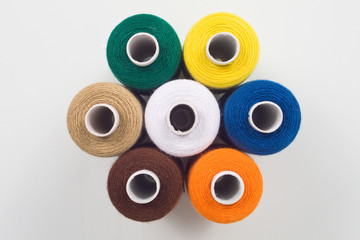 colored sewing spools in hexagon shape