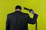 Businessman committing suicide with a gas nuzzle poster