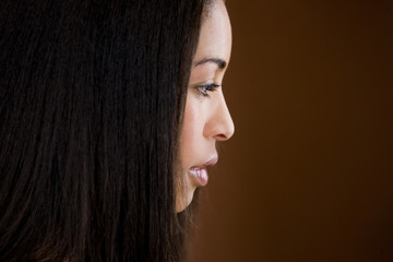 A young black woman with long dark hair