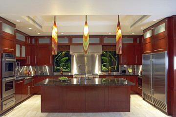 Large Contemporary Kitchen with Windows Flanking Stove