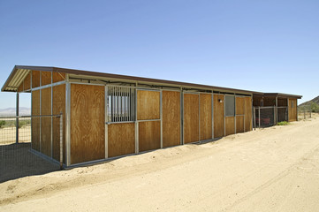 A stable outbuilding on a modern working ranch in the desert