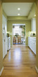 View through Light Green Kitchen with White Cabinets