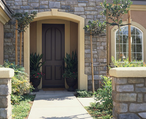 Walkway to Front Door of House with Stone Facade