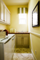 Laundry Room with Tiled Countertop on Cabinet