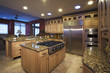 Stainless Steel Appliances and Wooden Cabinets in Kitchen