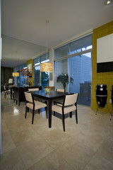 Contemporary Dining Room with Doors to Patio