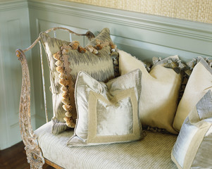 Throw Pillows on Antique Metal Bench