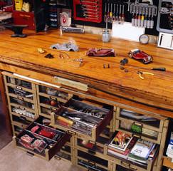 Vintage Toy Cars on Workshop Counter