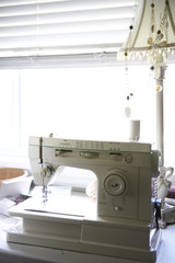 Sewing Machine on Table by Window