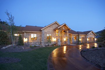 Wood and Stone Suburban House at Twilight