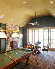 A snooker table is placed centrally in the room
