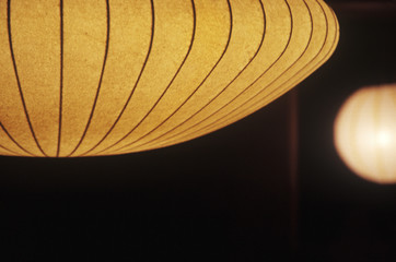 Close up of a large Nelson lantern against a black background