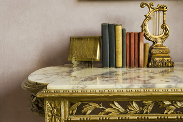 Books on Marble Topped Table