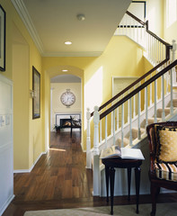 Hallway with Wood Floors and Carpeted Stairway