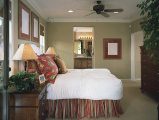 Traditional Bedroom with Light Green Walls and Red Accents