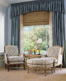 Armchairs by Large Window with Blue Curtains