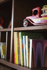 Bookcase with Children's Books and Toy Fire Truck