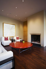 Red Coffee Table in Front of Fireplace in Contemporary Home