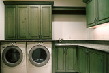Laundry Room with Green Stained Cabinets and Granite Countertops