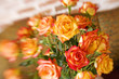 Blurred bouquet of red and yellow roses on welcome mat