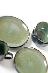 Stacked ceramic dishes with speckled green glaze