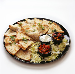 Delicious quesadillas served on the table