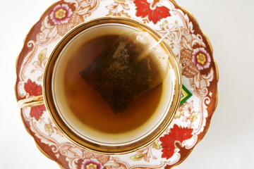 A decorative china teacup and saucer