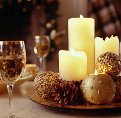 Warm Candles and Pinecones Highlight a Festive Centerpiece