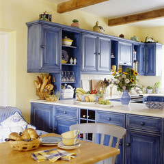 Blue Cabinets Enliven a Kitchen Decorated in Provincial Style