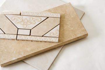 Strips of predesigned decorative tile
