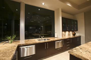 Spotlights illuminate a modern kitchen