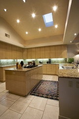 Spotlights illuminate an exquisite kitchen